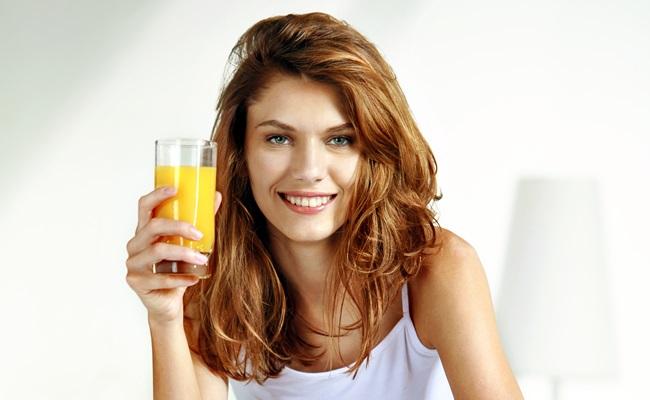 Glass of orange juice in bed