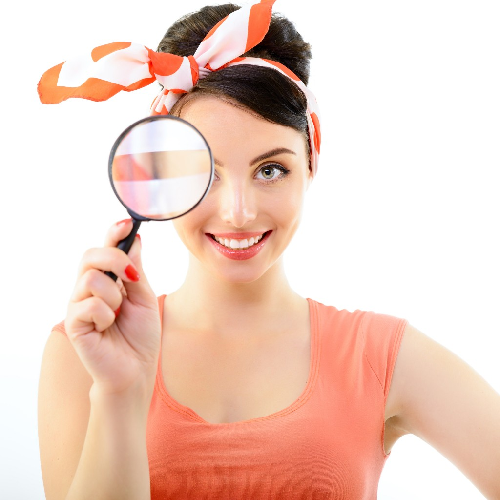 Pinup girl with magnifying glass, portrait of young happy sexy w