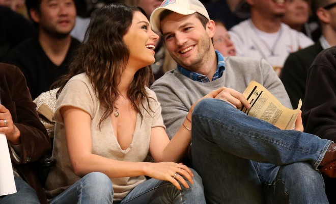 LOS ANGELES, CA - DECEMBER 19:  Actors Ashton Kucher and Mila Kunis attend the game between the Oklahoma City Thunder and the Los Angeles Lakers at Staples Center on December 19, 2014 in Los Angeles, California.  NOTE TO USER: User expressly acknowledges and agrees that, by downloading and or using this photograph, User is consenting to the terms and conditions of the Getty Images License Agreement.  (Photo by Stephen Dunn/Getty Images)