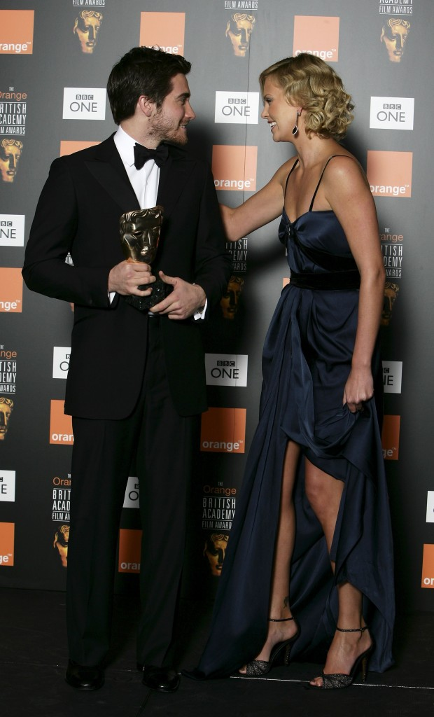LONDON - FEBRUARY 19: Actress Charlize Theron presents Jake Gyllenhaal with the award for Actor in a Supporting Role in the Awards Room at The Orange British Academy Film Awards (BAFTAs) at the Odeon Leicester Square on February 19, 2006 in London, England. (Photo by Dave Hogan/Getty Images)