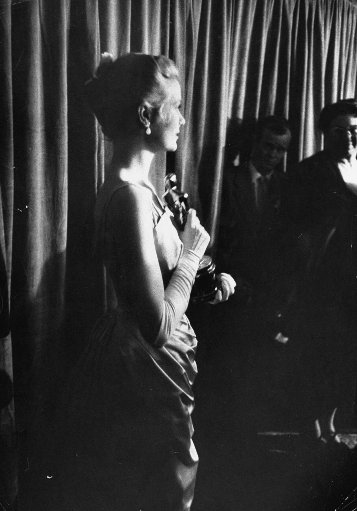Actress Grace Kelly clutching her Oscar for Best Actress in the movie  Country Girl as she stands backstage during the 27th annual Academy Awards ceremony at the RKO Pantages theater.  (Photo by George Silk/The LIFE Picture Collection/Getty Images)