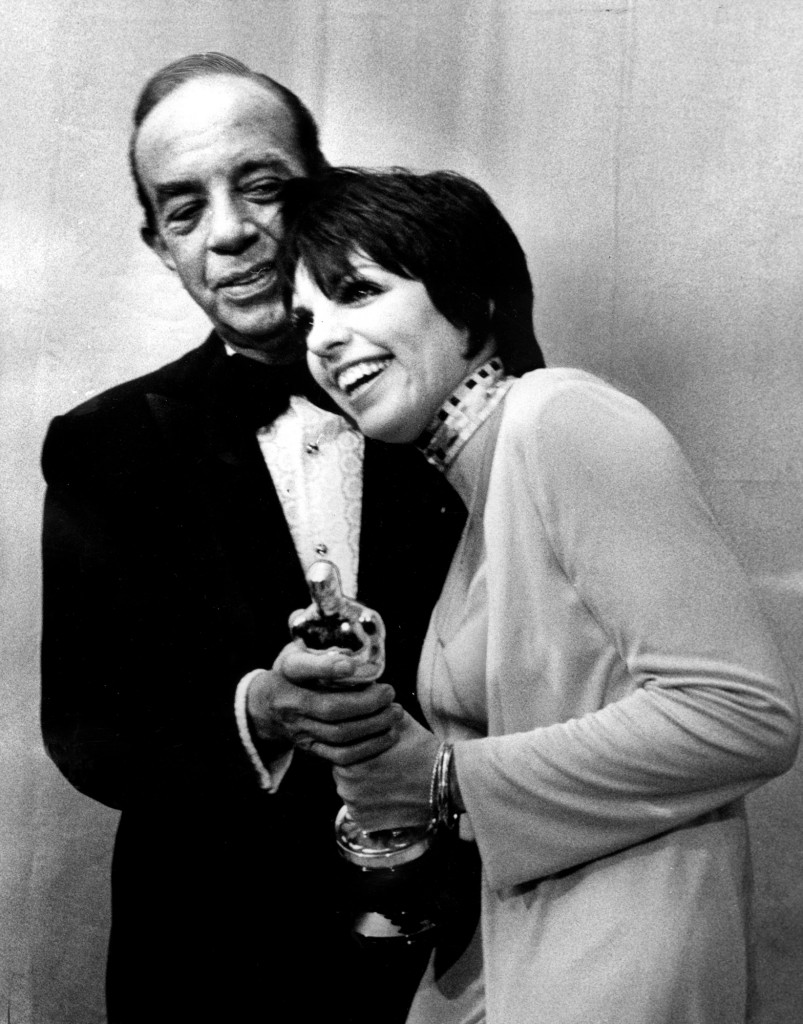 "Liza Minnelli, holding her Oscar, is congratulated by her father, Vincent Minnelli, backstage at the Music Center. She won best actress for her role in ""Cabaret"".  (Photo by Rick Browne/Los Angeles Times via Getty Images)"