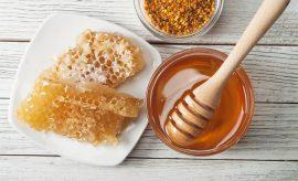 Still life with honey, honeycomb, pollen