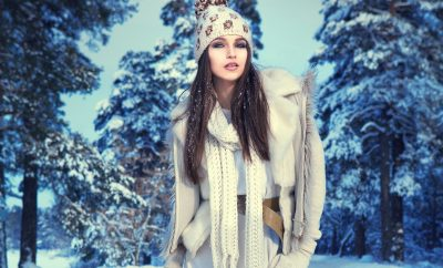 a beautiful girl in the winter forest