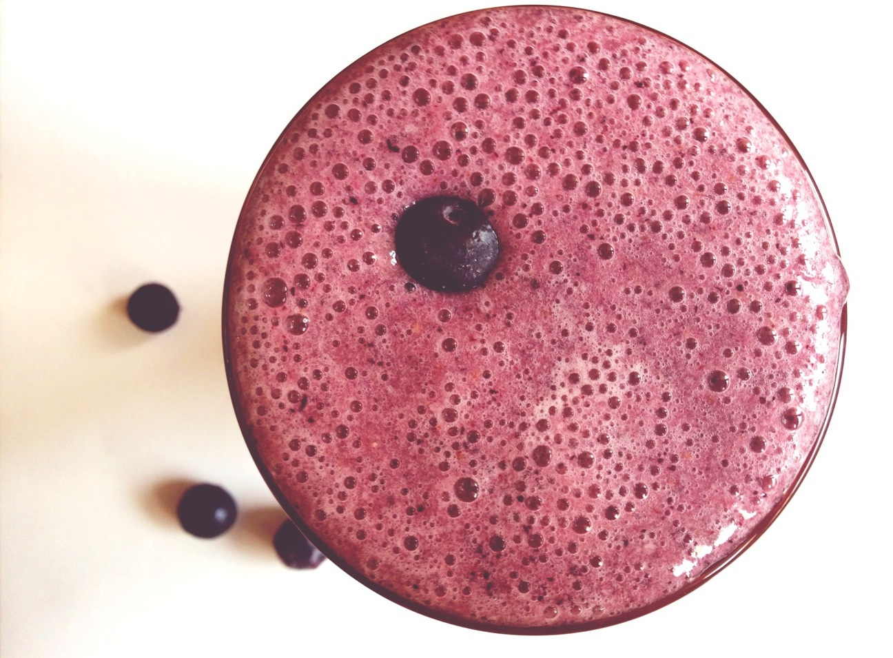 Directly above shot of blueberry banana strawberry smoothie on table